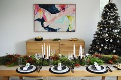 Contemporary Australian Christmas table setting. Using bottle brush native flowers as a centrepiece and black tableware, this is what a modern Australian Christmas setting looks like!