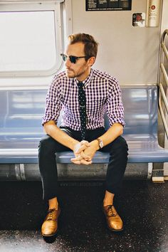 Plaid shirt and dotted necktie.