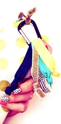 Use a carabiner to keep your hair ties organized. | 12 Household Hacks That Are Useful For Everyone