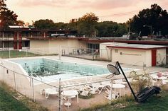 Abandoned Motel Pool Photography -   The No Life Guard on Duty Series Still Exhibits a Seed of Life