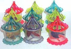 1950′s Twinkler Plastic Sparkly Spinner Christmas ornaments.  They add movement to the tree from the heat of the tree lights.