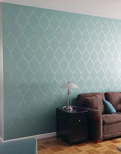 A DIY stenciled living room accent wall using the SErenity Allover Stencil from Cutting Edge Stencils. http://www.cuttingedgestencils.com/serenity-allover-stencil-trellis-design-wall-pattern-diy-decor.html