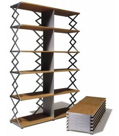 Thut Mobel makes a range of modern collapsible furniture including an aluminum table with wheels that folds with a single handle, a wooden shelf that collapses to high and a metal bed frame that adjusts to any size mattress. Folding Furniture, Space Saving Furniture, Cool Furniture, Furniture Design, Nomadic Furniture, Flexible Furniture, Bookshelf Table, Book Shelves, Foldable Bed