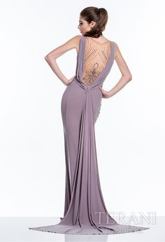 Jersey+evening+gown+with+pleating+along+the+straps+and+bust,+the+dress+is+finished+with+embellished+nude+illusion+detailing+down+the+center+neckline+and+along+the+back,+and+complimented+with+an+embellished+belt+at+the+waist