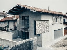 This renovated concrete house features stone curtains that add interest to the facade of the home, and create interesting patterns inside when the sunlight hits them. Brick Architecture, Architecture Details, Interior Architecture, Chinese Architecture, Futuristic Architecture, Facade Design, House Design, Beton Design, Building Renovation
