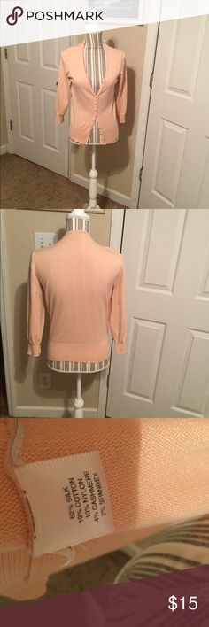 Ann Taylor peach/salmon colored sweater. Great sweater with fabric covered buttons in great shape.  No snags, pilling, or stains.  Peach/salmon colored, with 62% silk, 19% cotton, 13% nylon, 4% cashmere, and 2% spandex. Ann Taylor Sweaters Cardigans