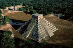 "Chichen Itza castle, Yucatán province, Mexico - photo by Yann Arthus-Bertrand; ""The capital of the Itzas, a northern Toltec people who invaded the Mayan empire in the 10th century, Chichen Itza is a ... testimony to the union of the two cultures. The castle's ... pyramid, comprising ninety-one steps on each of its four sides and topped by a platform, represents the 365 days of the Mayan calendar."" A shadow image of a snake forms on the north face during the vernal and autumnal equinoxes."