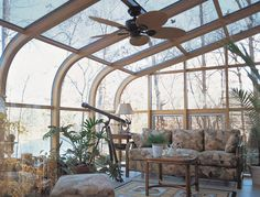 small glass room off family room, for staring at sky next to wood stove, gazing out in nature with a cup of tea, small, cozy.