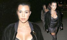 Kourtney Kardashian flashes nipples in silk slip at Paris Fashion Week