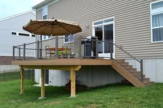Vertical cable aluminum deck railing from Kidron Vinyl Led Stair Lights, Stair Lighting, Railing Design, Deck Design, Railing Ideas, Stair Kits, Stainless Steel Cable Railing, Cable Railing Systems, Aluminum Decking