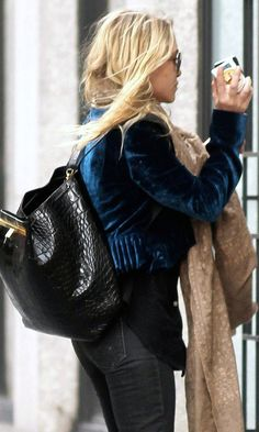 Mary-Kate Olsen goes out in a royal blue velvet jacket and a black croc backpack. #style #fashion #olsentwins