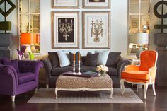 A Smokey Grey Sofa Creates Beautiful Base For The Pops Of Violet And Orange In