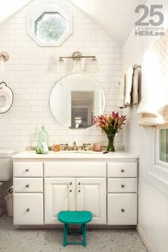 Bathroom Love (I especially appreciate the Baby Bjorn toilet ring hanging on  the wall!)