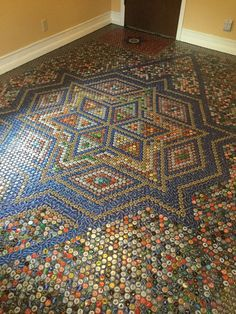 Homeowner collects bottle caps for a year—look at her floor now!.....OH MY GOSH.! HOW TALENTED,!
