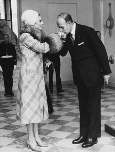 Empress Farah Pahlavi of Iran, greeted by French president, Valerie Giscard d'Estaing 1976