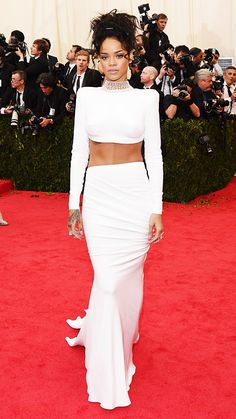 STELLA MCCARTNEY, 2014 Rihanna looked white hot at the 2014 Met Gala in this couture Stella McCartney crop top and exquisitely draped long skirt and train, which she paired with a diamond choker necklace.