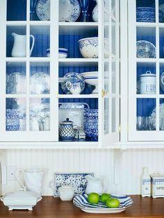 Mediterranean white and blue kitchen cabinets