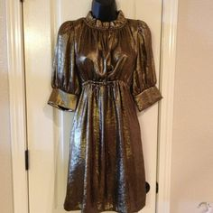 Collective Clothing Bronze Metallic Dress New without tags.Adjustable tie on front. 100% polyester. collective clothing  Dresses