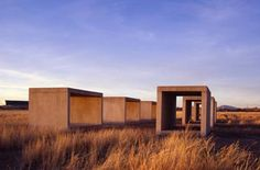 Donald Judd boxes. Chinati Foundation. Marfa.  Sky, grasses, light --- lovely photo.