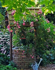 wishing well with hanging bucket...lovely