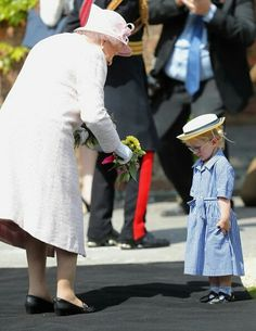 QEII Receives A Bouquet From A Little Lady At The Royal Regiment Of Artillery 300 Year Celebrations,  May 26, 2016.