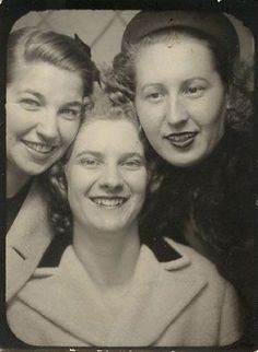 Friends in a  photo booth. C.1940s...