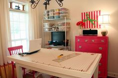 sewing room. Love the pink dresser!