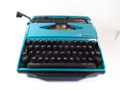 Mid Century Teal Ghia or Super G Smith Corona by PherdsFinds