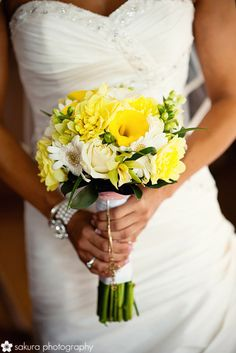 A similar type of bouquet for the bridesmaid, white, yellow and green. Would like it smaller than pictured and without calla lilies because they are expensive! Would need 4 bridesmaid bouquets.