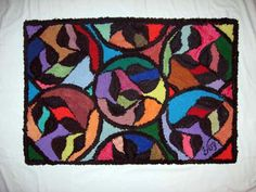 designed and hooked by Val Galvin, Renditions in Rags, using recycled/reclaimed wool fabric.