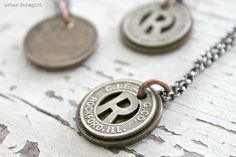 """"""" our city our story """"....limited edition vintage transit token necklaces supporting our love of Rockford, IL"""