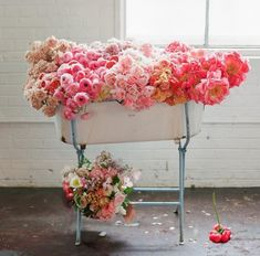 A large pink ombre floral arrangement ideal for a glamorous modern wedding. | Tulipina