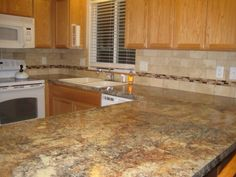 Look at this amazing laminate counter by Formica. They've really created some realistic stone looking patterns. Keeps your pricing down. Add a full height backsplash to really dress up the room. You can make a space look wonderful even on a budget.   Formica and tile available at Color Tile & Carpet in Salem, Oregon