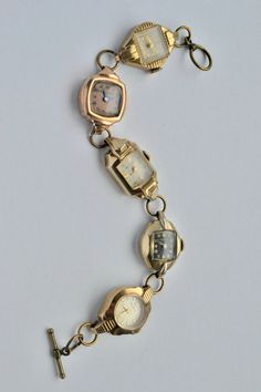 Recycled Vintage Jewelry Ladies Watch Bracelet OOAK Steam Punk Art 5 Faces Gold Art Deco. $64.99, via Etsy.