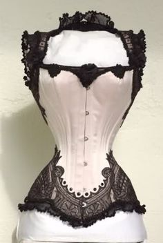 It's the front of that corset I pinned a few days ago!  And it's GORGEOUS.  All the high-backed corsets I've seen are underbusts, but this is amazing.