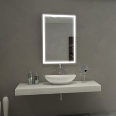 Add contemporary style to your home or office when you update your space with the Paris Mirror Verano Illuminated LED Bathroom Mirror. This rectangular mirror is framed with two vertical lights for an added touch. Backlit Bathroom Mirror, Led Mirror, Mirror With Lights, Lighted Mirror, Mirror Vanity, Wall Mirrors, Illuminated Mirrors, Home Decor Mirrors, Beautiful Mirrors