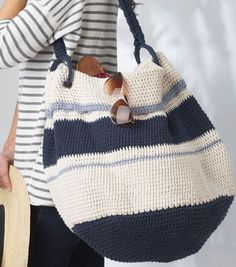 Crochet Bags Design Ravelry: Nautical Hobo Bag pattern by Bernat Design Studio - Crochet Hobo Bag, Crochet Beach Bags, Crochet Handbags, Crochet Purses, Diy Crochet, Crochet Crafts, Crochet Projects, Crochet Bags, Nautical Crochet