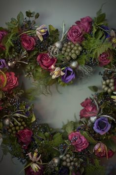 Heart shaped floral wreath with ferns, snake's head fritillary and berries from www.jayarcherfloraldesign.com
