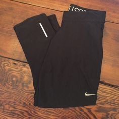 Nike Dri-Fit Cropped Pant Worn once or twice, excellent condition. Drawstring at waist, zipper pocket on back right. 92% polyester, 8% spandex.  {I list all of my items very close to what I'm willing to sell them for. I do not trade. Please make all reasonable offers through the offer button!} Nike Pants Track Pants & Joggers