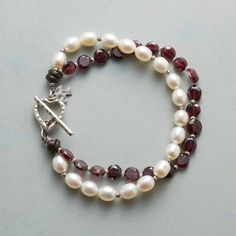 "LOVE KNOTS BRACELET -- Strands of fiery garnets and cultured pearls meet together. Heart-shaped toggle bracelet clasp in sterling silver. A handmade exclusive. 7-1/4""L."