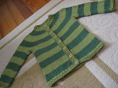 A seamless baby/toddler cardigan knit from the bottom up in worsted-weight yarn. The fronts and back are knit together in one piece, and the sleeves are knit separately in the round then added to the body of the sweater before working the round yoke. The buttonband is knitted into the sweater as you go along using intarsia.