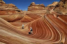Close your eyes and imagine yourself walking into a humongous vat of cinnamon taffy. That's what went through my mind as we entered this weird, dreamlike world of swirling colors and psychedelic patterns. Maybe it was the desert heat, but it all looked like gooey taffy, stretched over huge mounds and 50-foot canyon walls. The surrounding buttes were heaps of melting rocky road ice cream.