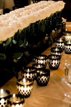 Black and white candle centerpieces with white roses, photo by Yvette Roman Photography