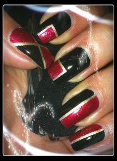 Black, red and gold nail art