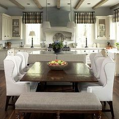 Loving the large farmhouse style table in this kitchen. #familygatherings #kitchen #eatinkitchen
