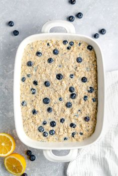 Beautiful lemon blueberry baked oatmeal made with fresh lemon juice & zest and naturally sweetened with pure maple syrup. This lemon baked oatmeal is gluten free & dairy free with bursts of fresh blueberries and poppy seeds in every bite. Drizzle with a homemade lemon yogurt topping for the perfect breakfast treat! #oatmeal #bakedoatmeal #blueberries #healthybreakfast #easter #brunch Oatmeal Flour, Baked Oatmeal, Easy Rice Pudding, Breakfast Recipes, Dessert Recipes, Desserts, Lemon Yogurt, Baked Salmon, Perfect Breakfast