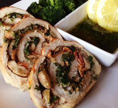 Pork tenderloin stuffed with spinach, mushrooms, garlic, bacon and fresh herbs and topped with a lemon parsley oil drizzle.