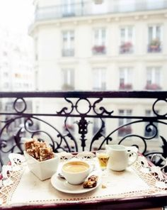 Coffee on a Parisian balcony.... (tiny portions of yummy... cute little (cheap) stoneware a tray and a frilly placemat