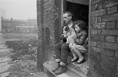 Nick Hedges, the photographer, was shocked by the condition, but also encouraged by the strength of family units. These two people sait in bleak surroundings with their pet dog, but they sit together