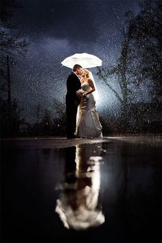 "Why We Love It: This beautiful photo might just have you wishing for rain on your wedding day!Why You Love It: ""Because there is nothing like kissing in the rain!"" —Helen M. ""It's like a scene of a movie, captured and frozen in time as a photograph."" —Luciana M. ""This just enhances the love stemming from this couple! I hope I can get a pose like this on my big day! Simply stunning, no other words needed!!"" —Courtney L. ""It's a gorgeous shot of a very special day. Wonderful lighting."" —Dawn…"